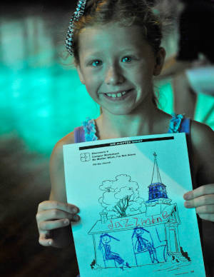 Girl displaying her drawing.