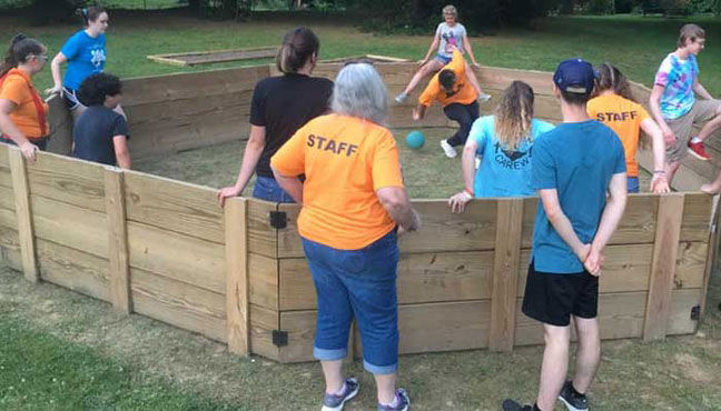 Playing in the gaga pit at Camp Carew.